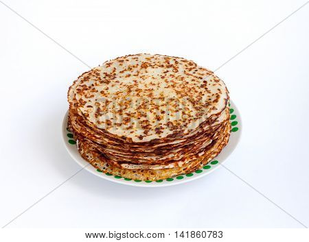 Cookery. Food. Fried pancakes round a pile on a plate