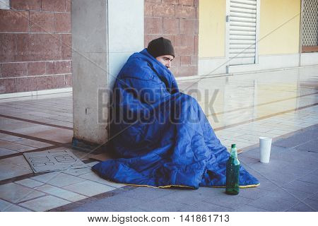 Homeless Lying On The Street Alone