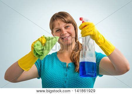 Young Smiling Housewife Woman With Cleaning Means
