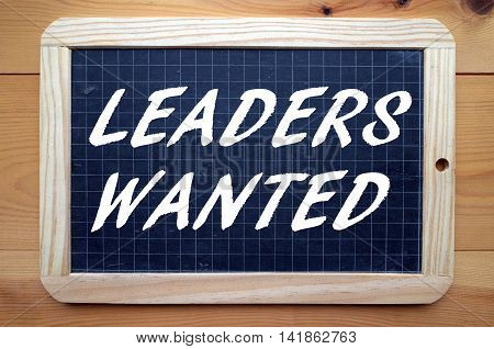 The words Leaders Wanted in white text on a blackboard