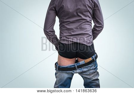 Standing Man Has Undress Jeans And Peeing