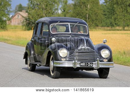 SOMERO, FINLAND - AUGUST 6, 2016: Black 1950s BMW 340 classic car takes part in the 90 km Maisemaruise 2016 drive along scenic roads of Tawastia Proper Finland. Public event.