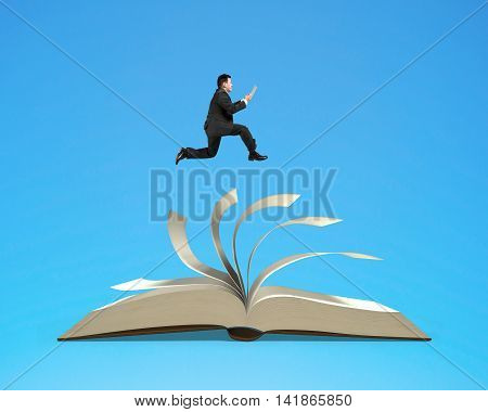 Man Holding Tablet Running On Open Book