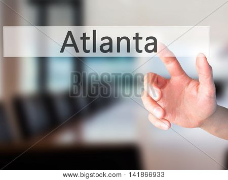 Atlanta - Hand Pressing A Button On Blurred Background Concept On Visual Screen.
