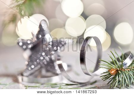 Silver Christmas star with needles and christmas decoration