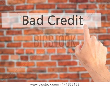 Bad Credit - Hand Pressing A Button On Blurred Background Concept On Visual Screen.