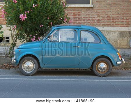 ROME ITALY - CIRCA JULY 2016: light blue Fiat 500 car parked in a street of the city centre