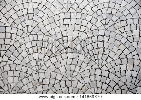 closeup of a marble cobblestone pavement with curvature pattern