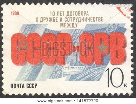 MOSCOW RUSSIA - CIRCA APRIL 2016: a post stamp printed in the USSR dedicated to the 10th Anniversary of USSR-Vietnam Friendship circa 1988