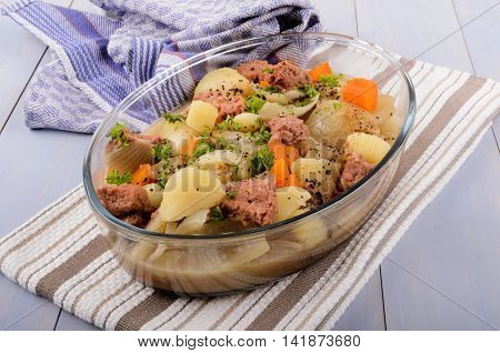stovies with onions carrots potatoes and corned beef a scottish specialty