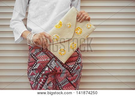 Young woman with fashion details on white wall background