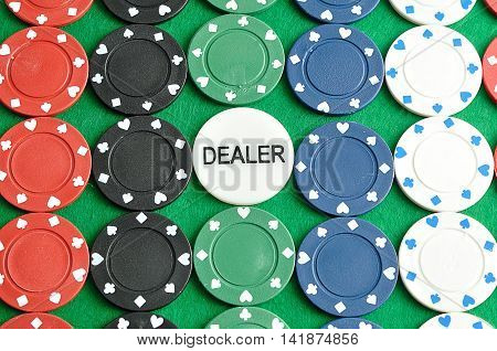 Rows of poker chips with a dealer chip