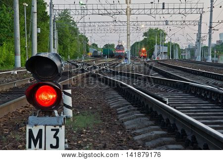 red semaphore signal on the railway in summer