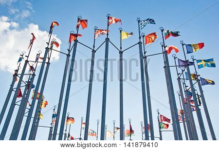 Flags On Background Of The Blue Sky With Clouds