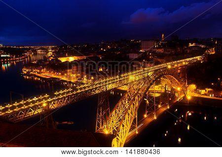 bridge of Dom Luis I in old Porto at night, Portugal, toned