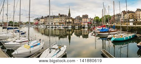 Panoramic view of old harbor at sunset. The moored yachts and medieval houses in Old Harbor. Honfleur, Normandy France