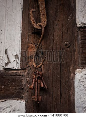 The old rusty key on wall of farmhouse