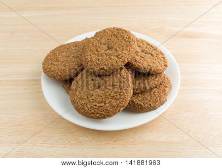 A plate of oatmeal sugar free cookies on a wood table top.