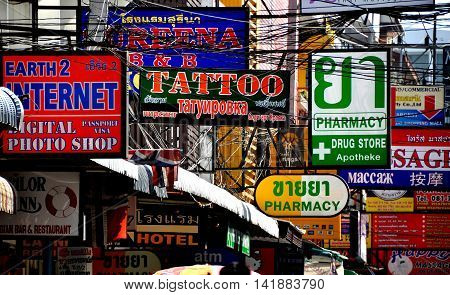 Pattaya Thailand January 2 2014: A jumble of signs and electrical wires hang from store fronts on a small Soi connecting Pattaya Beach Road and Second Pattaya Road