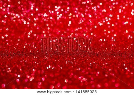 Abstract red shiny glitter defocused background. Valentine christmas or other festive concept