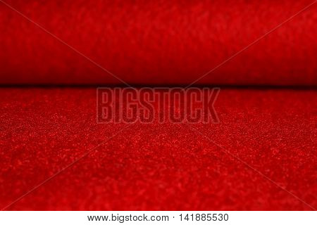 Red velvet surface. Table and blurred background