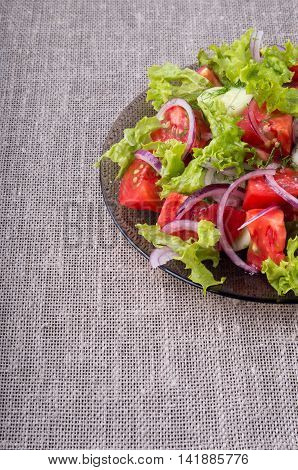 Fragment Of A Transparent Plate With A Fresh Salad Closeup