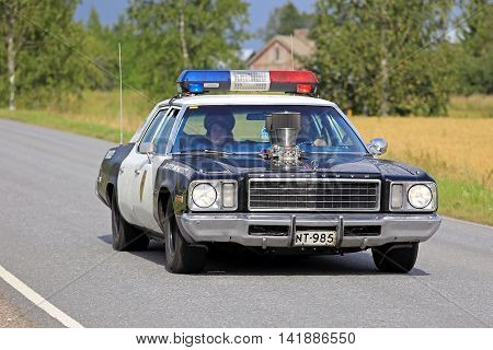 SOMERO, FINLAND - AUGUST 6 2016: Customized and modified American Plymouth Police car takes part in the 90 km Maisemaruise 2016 drive along scenic roads of Tawastia Proper Finland. Public event.