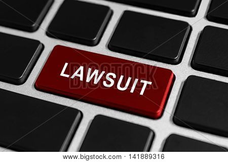 lawsuit red button on keyboard business concept