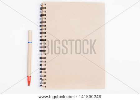 White Desk With Blank Notepad