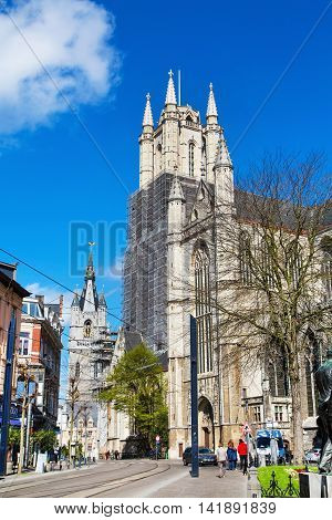 Ghent, Belgium - April 12, 2016: St Bavo's Cathedral and people in popular touristic destination Ghent, Belgium