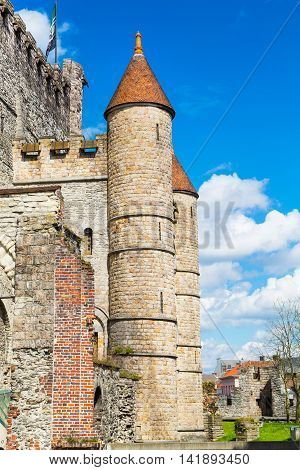 Gravensteen castle or Castle of the Counts in Ghent, Belgium against cloudy blue sky