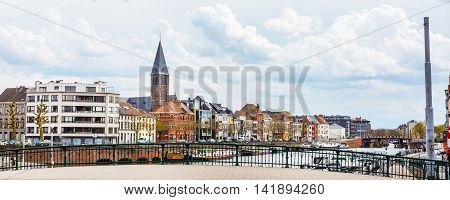 Ghent, Belgium - April 12, 2016: Panorama with old colorful traditional houses along the canal and boats in popular touristic destination Ghent, Belgium