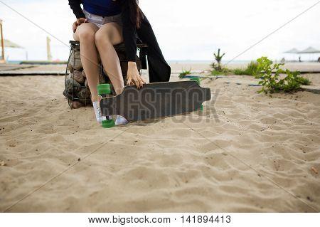 Longboarder On The Beach