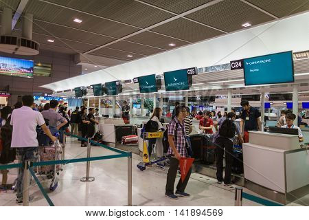 Tokyo, Japan - June 21, 2016: Passengers at Cathay Pacific check-in counter at Narita International Airport, Tokyo, Japan. Cathay Pacific is a flag carrier in Hong Kong and one of the biggest airlines in Asia.,