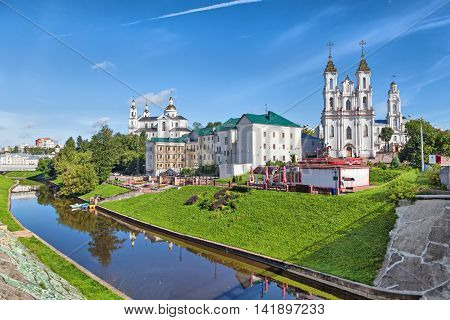 Vitebsk skyline with Resurrection church town hall and buildings on the side of Vitba river Belarus