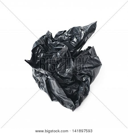 Black polyethylene trash bag crumpled in a ball isolated over the white background