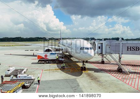 Changi Airport-Singapore,June 6,2015:Airport officials are checking the completeness of flying Thai Airways to fly from Changi Airport Singapore to Bangkok Thailand.