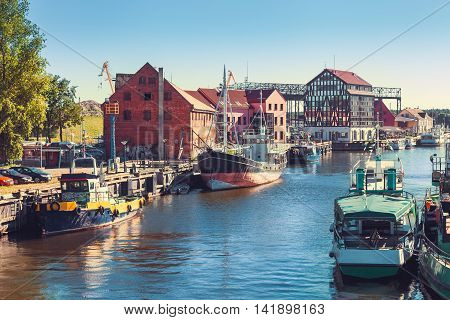 Ships and boats on Dane river in Klaipeda Lithuania.