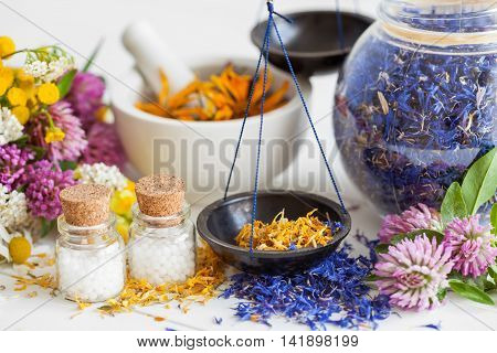 Bottles Of Homeopathy Globules, Scales, Jar And Mortar Of Healthy Herbs. Selective Focus. Herbal Med