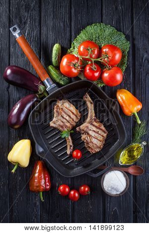 loin on the bone grill pan with fresh vegetables