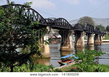 Kanchanaburi Thailand - December 24 2010: The legendary railway Bridge on the River Kwai made famous in the 1957 David Lean film of the same name