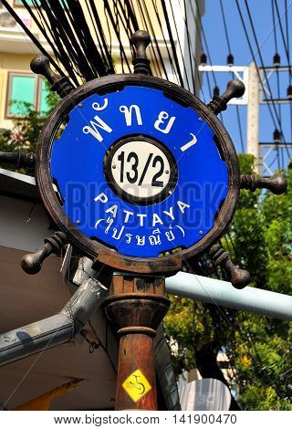 Pattaya Thailand - January 5 2014: Pattaya street sign in the shape of a ship's steering wheel *