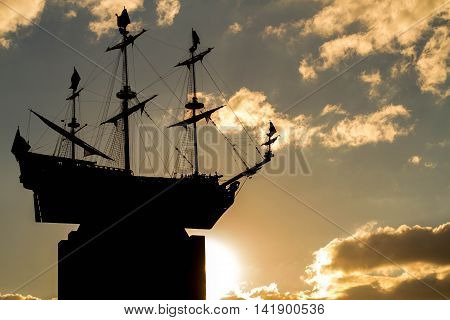 Sankt-St. Petersburg-04.08.2016: a sailing vessel sculpture with three masts against a decline