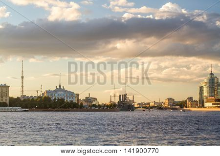 St. Petersburg - 7/31/2016: a view of Neva Embankment at sunset with movable bridges
