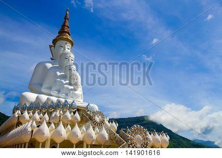 front of five white Buddha with sky at Wat Pha Sorn Kaew Khao Kho Phetchabun THAILAND.