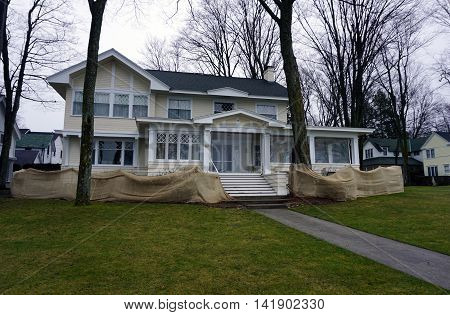 WEQUETONSING, MICHIGAN / UNITED STATES - DECEMBER 22, 2015: A large yellow home on Beach Drive in Wequetonsing, Michigan.