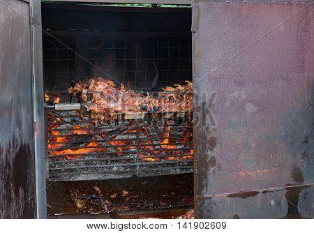 Suckling pig on a skewer for grilling