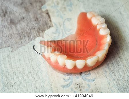 Dentures on wooden table ,Vintage filter and selective focus