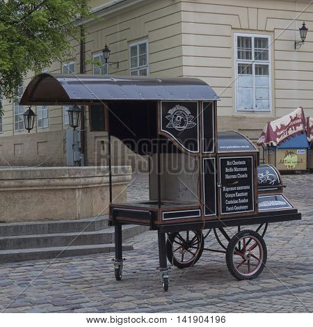 LVIV UKRAINE - MAY 5 2013: Stylized wagon-roaster for sale roasted chestnuts early in the morning in Lviv