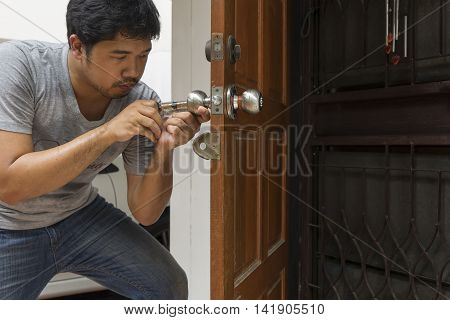 locksmith open the wood door with special tool in hot wether - can use to display or montage on product
